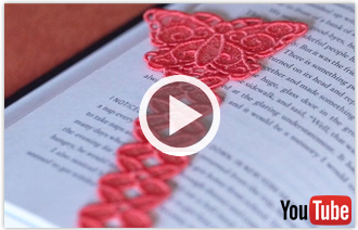 Free video with instructions on how to embroider freestanding lace bookmarks with ribbon.