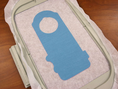 Free project instructions to embroider in-the-hoop doorknob hangers.