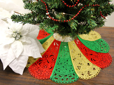 Free project instructions to embroider a Freestanding Lace Tree Skirt.