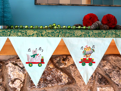 Free project instructions to embroider a holiday mantel scarf.