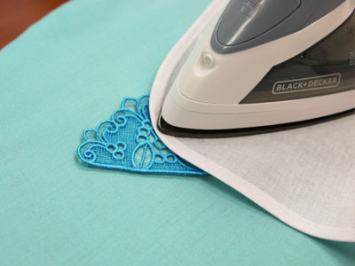 Free project instructions on how to embroider lace insets for v-necks.