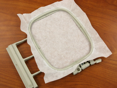 Free project instructions to embroider in-the-hoop luggage tags.