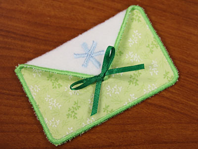 Free project instructions to embroider in-the-hoop gift card holders.