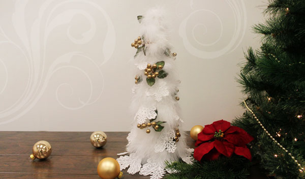 Free project instructions to embroider a lace Christmas tree.