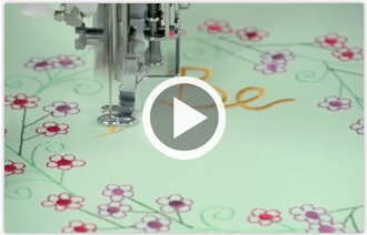 Free video with instructions on how to embroider on quilted cotton fabric.