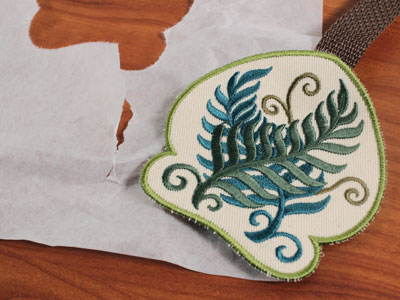 Free project instructions to embroider an in-the-hoop towel topper.