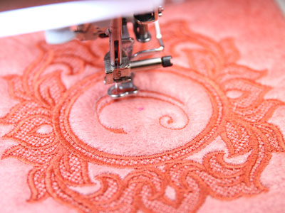 Free project instructions for layering embossed embroidery.