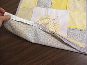 Free project instructions to embroider a patchwork pillow.