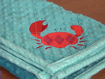 Free project instructions to embroider on minky fabric.