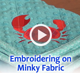 Free video with instructions on how to embroider on minky fabric.