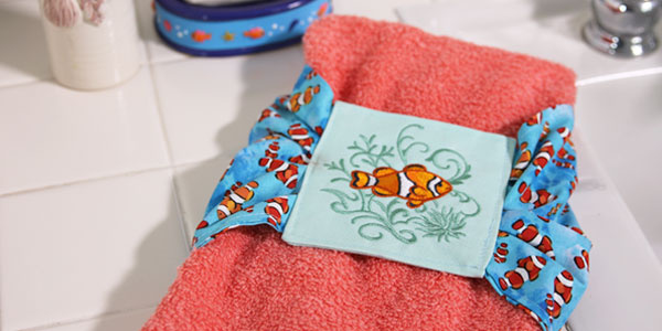 Free project instructions to make embroidered towel cozies.
