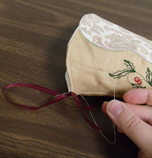 Free project instructions to make a victorian charm Christmas stocking.