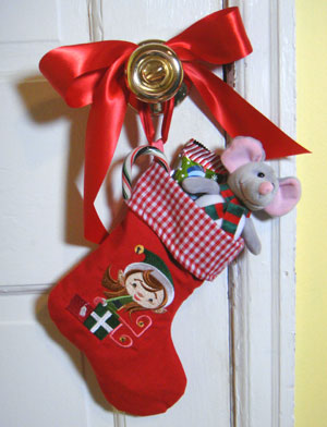 Free project instructions for embroidering an a-door-able stocking.