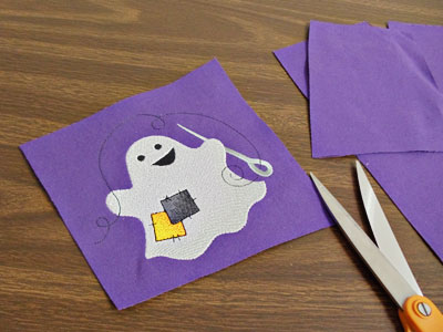 Free project instructions to create a ghostly greetings garden flag.