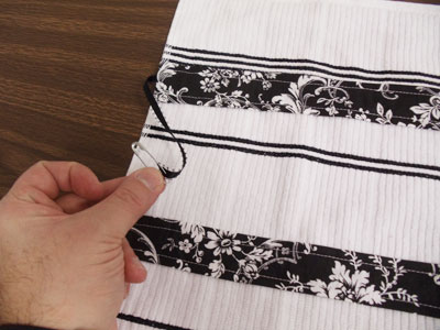 Free project instructions to embroider a stay-put kitchen towel.