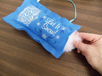 Free project instructions to create a Christmas Wish Pillow.