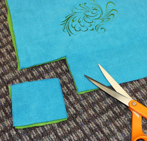 Free project instructions for a machine embroidery design fleece tie blanket .