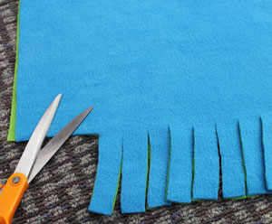 Free project instructions for a machine embroidery design fleece tie blanket . 80338ef17