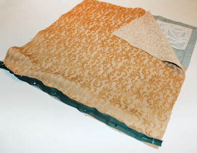 Free project instructions on how to embroider an battenburg lace pillow.