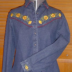 Denim shirt decorated with machine embroidery flower designs.