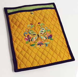 Free project instructions to embroider an iPad or tablet sleeve.