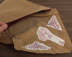 Free project instructions for an embroidered wallet made out of tea towels.