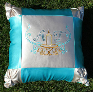Free project instructions to make a pretty pintuck pillow with machine embroidery designs.