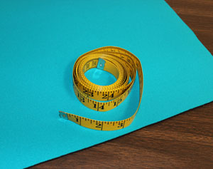 Free project tutorial to make an embroidered neoprene can koozie.