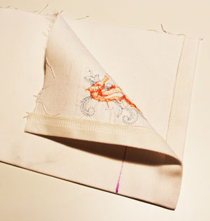 Free project instructions to make a machine embroidered shower curtain valance.