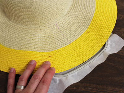 Free project instructions on how to embroider on straw hats.