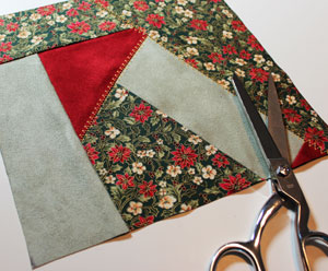 Free project instructions to make a patchwork Battenburg lace poinsettia Christmas pillow.