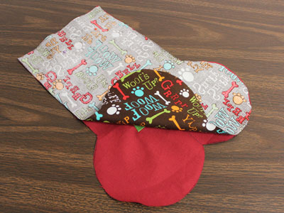 Free project instructions to make a bone-shaped Christmas stocking for a pet dog.