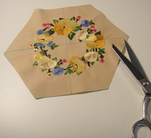 Free project instructions to make a quilted embroidered table topper.