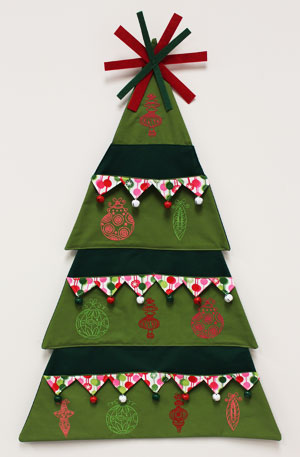 Free project instructions to make an embroidered Christmas tree card holder.