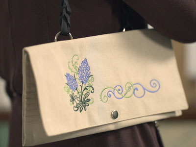 Free project instructions to turn a placemat into an embroidered pocketbook.