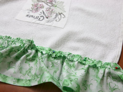 Free project instructions to create an embroidered ruffle towel.