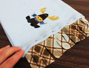 Free project instructions to make a fleece button scarf.