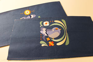 Free project instructions to make an embroidered handbag.