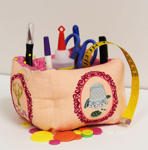 Free project instructions to make an embroidered pincushion organizer.