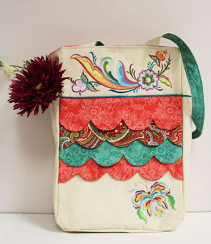 Free project instructions to make an embroidered scalloped tote bag.