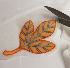 Free project instructions to make in-the-hoop embroidered organza leaves.