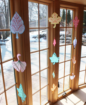 Free project instructions to make an organza leaf sun catcher.