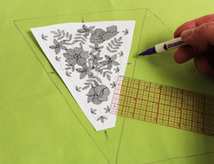 Free project instructions to make an embroidered springtime floral bunting.