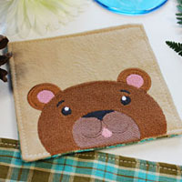 Free project instructions to embroider a towel border with an animal design.