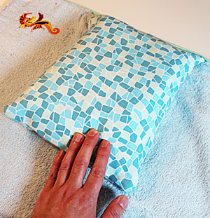 Free project instructions to make an embroidered changing pad with diaper caddy.