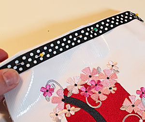 Free project instructions to make an embroidered tablet cover.