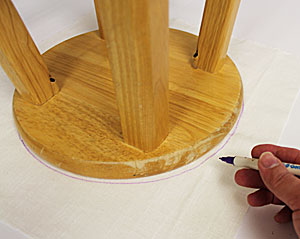 Free project instructions to upholster a round stool with embroidery.