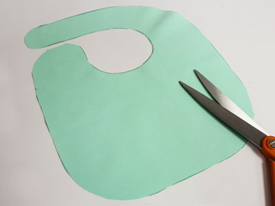 Free project instructions to embroider a hand towel baby bib with applique.