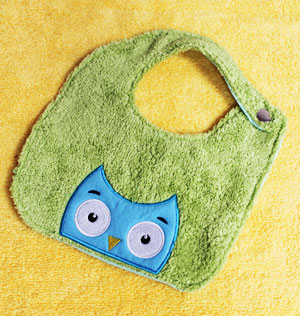 Free project instructions to make an embroidered baby bib from a hand towel.