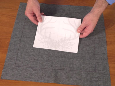 Free project instructions to embroider a tie-on pillow sham.